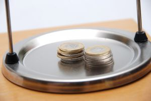 1172390_money_on_the_weighing_scale__1